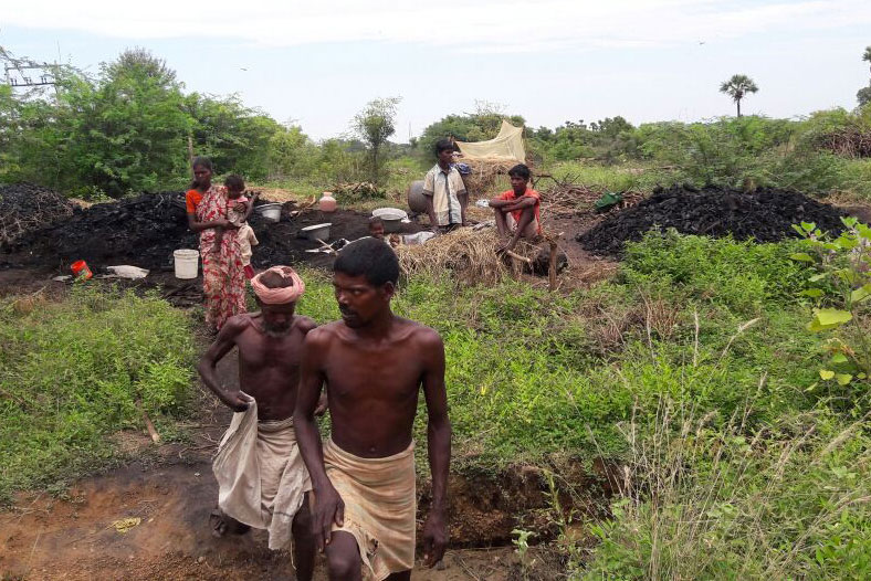 September 22: Laborers walk away from the wood-cutting and charcoal unit where they had been enslaved for up to five years outside of Chennai.