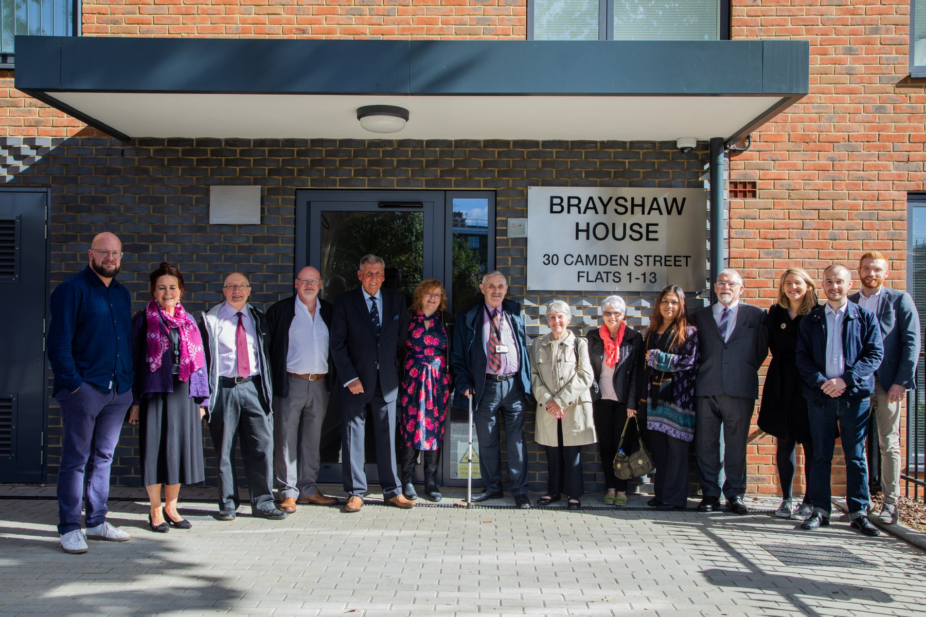 Peter Brayshaw's family and Camden councillors past and present welcome the new homes.