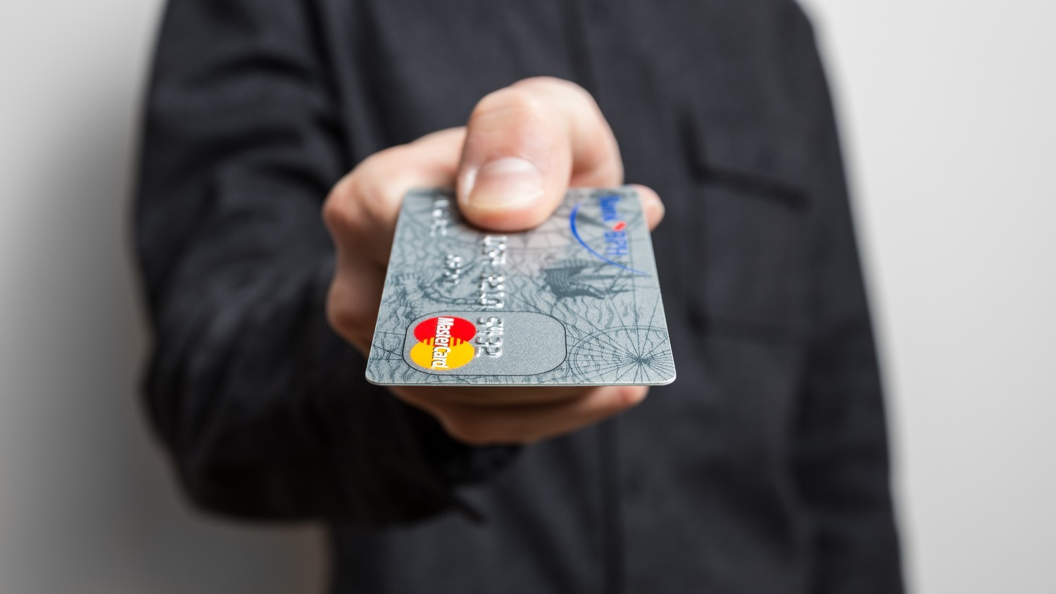 'Holding credit card' by CafeCredit.com (CC 2.0)