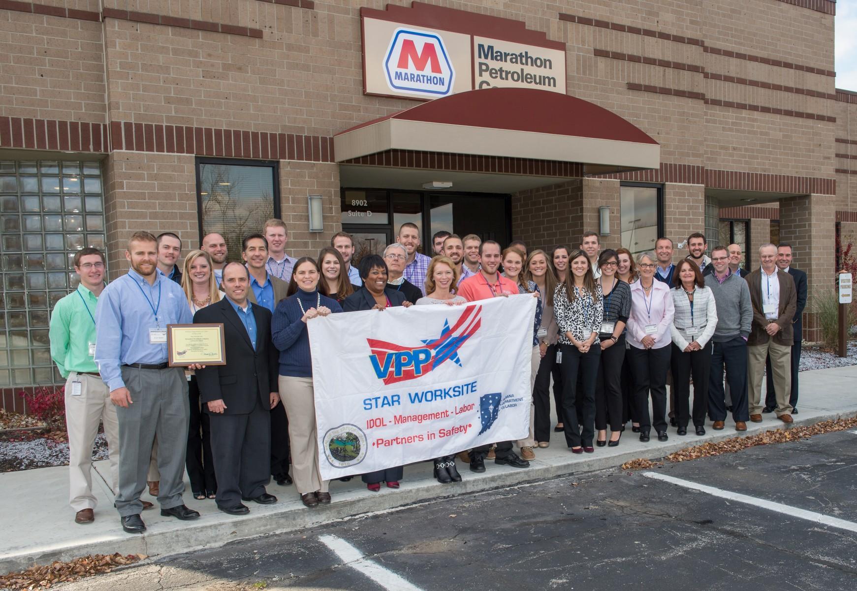 MPC employees at the Indianapolis office gather to celebrate the VPP Star Worksite award