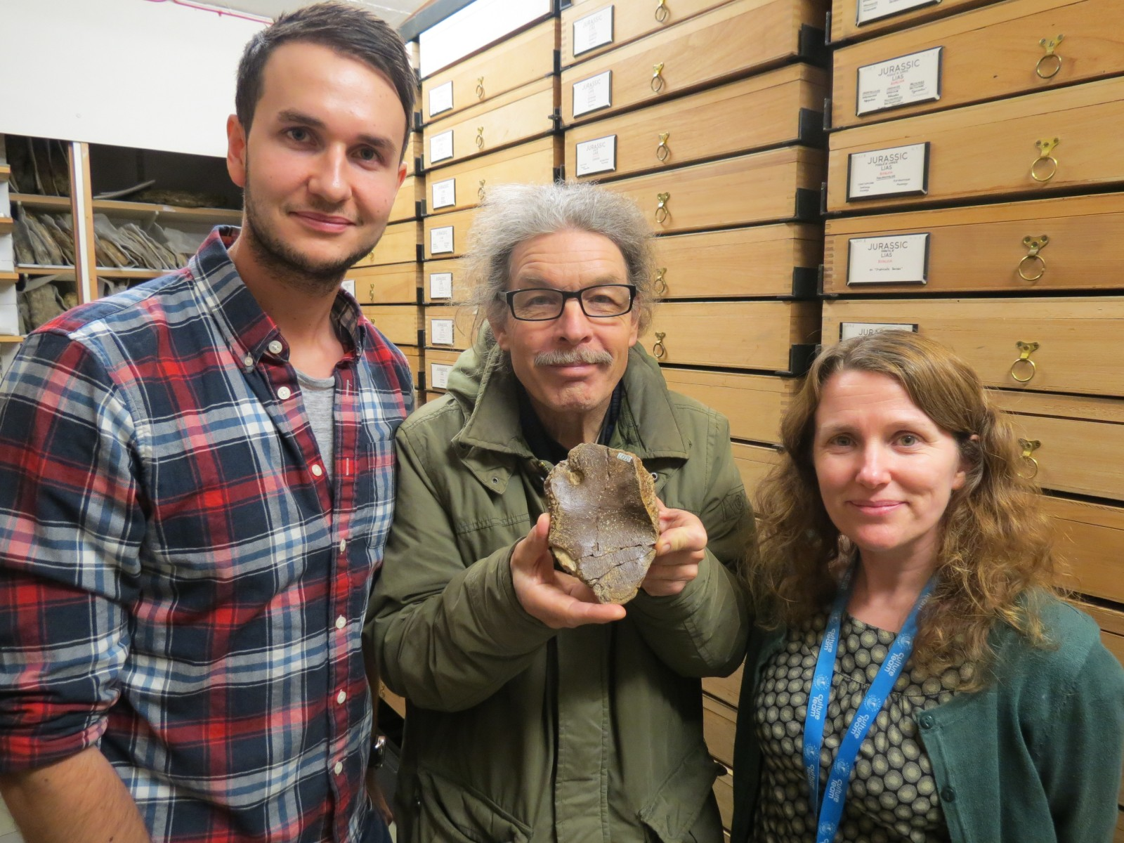 Photograph of Dean Lomax (left), Simon Carpenter (middle) and Deborah Hutchinson with the new specimen.