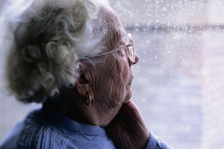 elderly-woman-looking-out-of-a-window.jpg