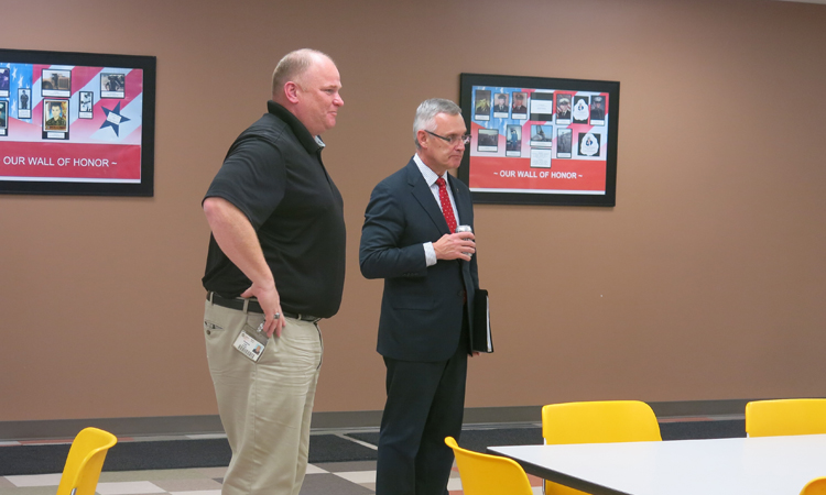 Coach Tressel and Tom Kall speaking to Crane's Elyria Site