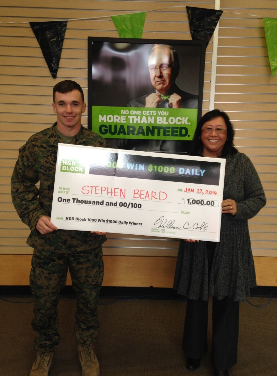 Stephen Beard, a local winner of the H&R Block 1,000 Win $1,000 Daily Sweepstakes