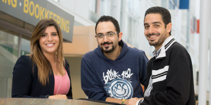 (From left) U of A alumna and volunteer Deanna Dow with Bassel and Aref Sayegh in HUB Mall (Photo: Richard Siemens)