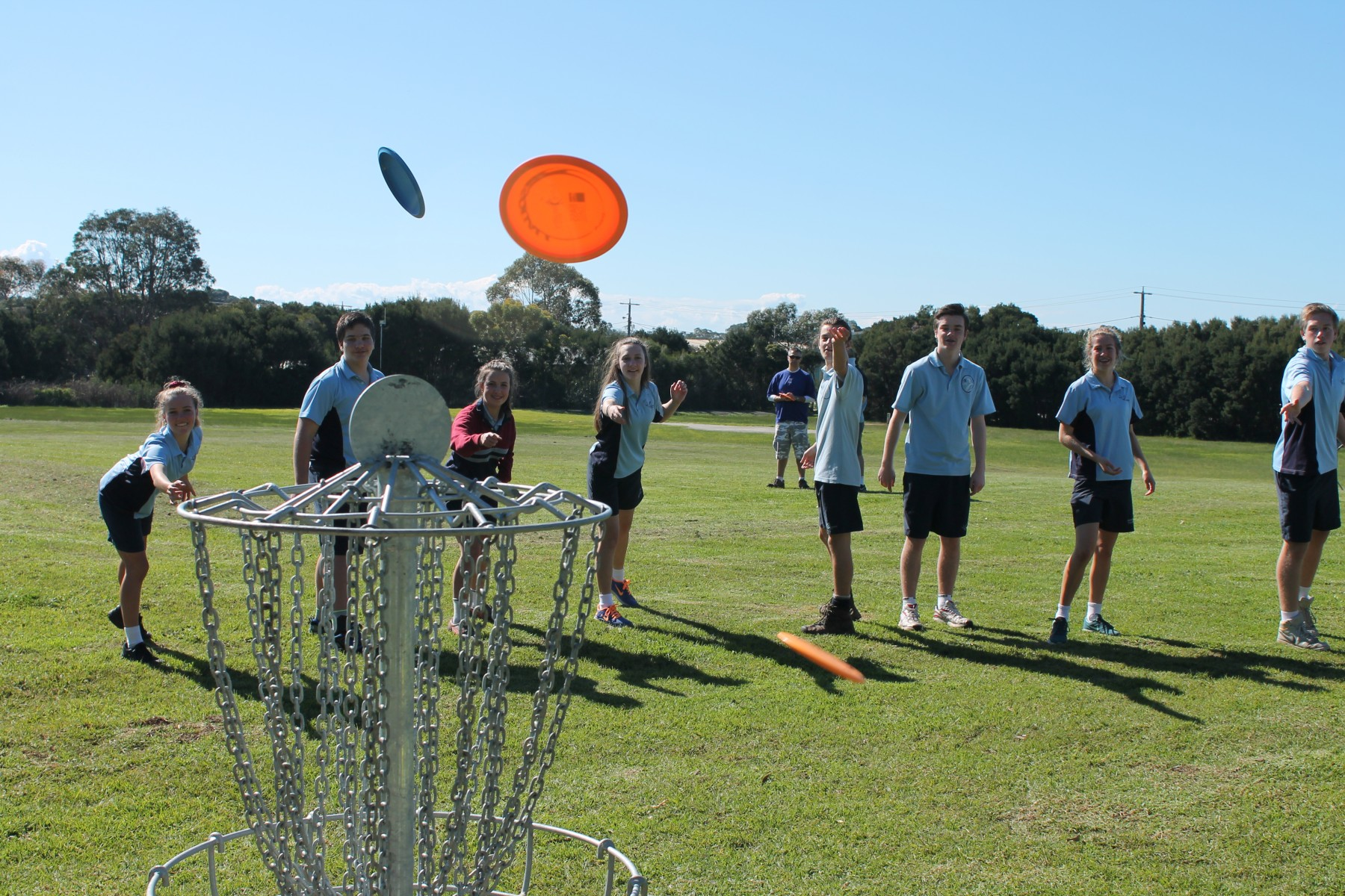 Newhaven College Year 9 students Annabelle Townsend, Apollo Christos, Ruby Hibbins, Brittany Gonzales, Anthony Passarin, Sam Duncan, Olivia Hughes, Hayden Vincent have a go at playing Frisbee golf at the Blue Gum Reserve Frisbee Golf Course launch.
