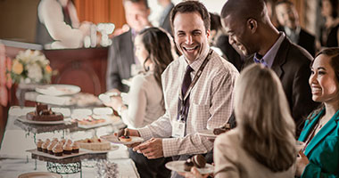 Guests enjoying desserts at a conference