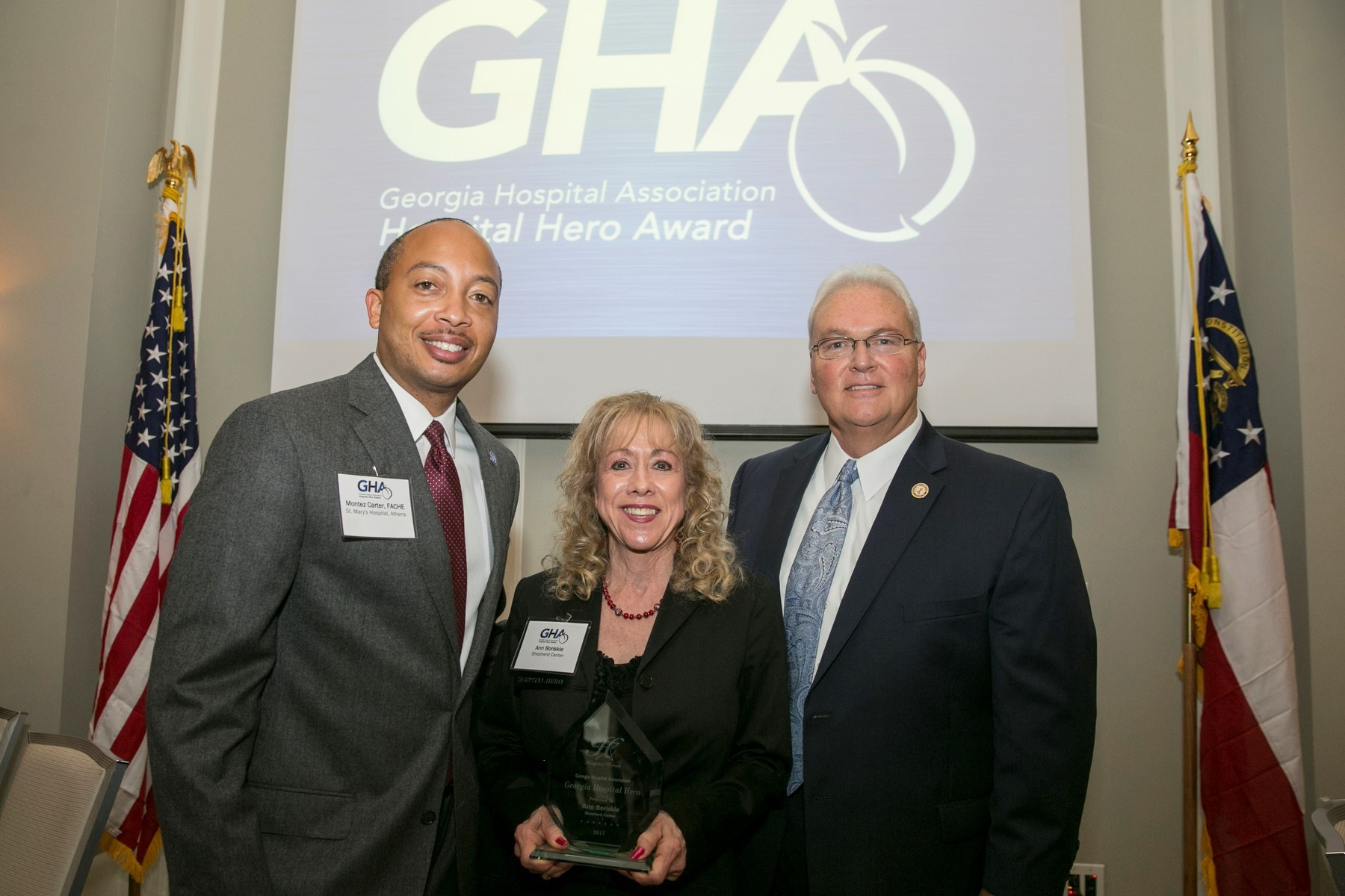 Montez Carter, FACHE (left),  Ann Boriskie and Georgia Hospital Association Board of Trustees Chair and Earl Rogers (right), Georgia Hospital Association President and CEO.