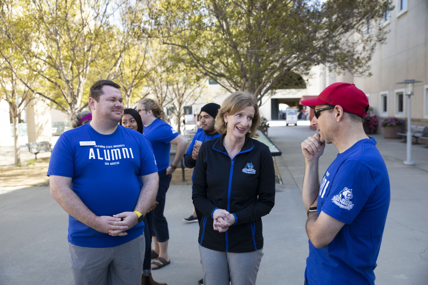 Keifer-Wheals with President Ellen Neufeldt and a fellow alumnus on alumni day of service in 2019.