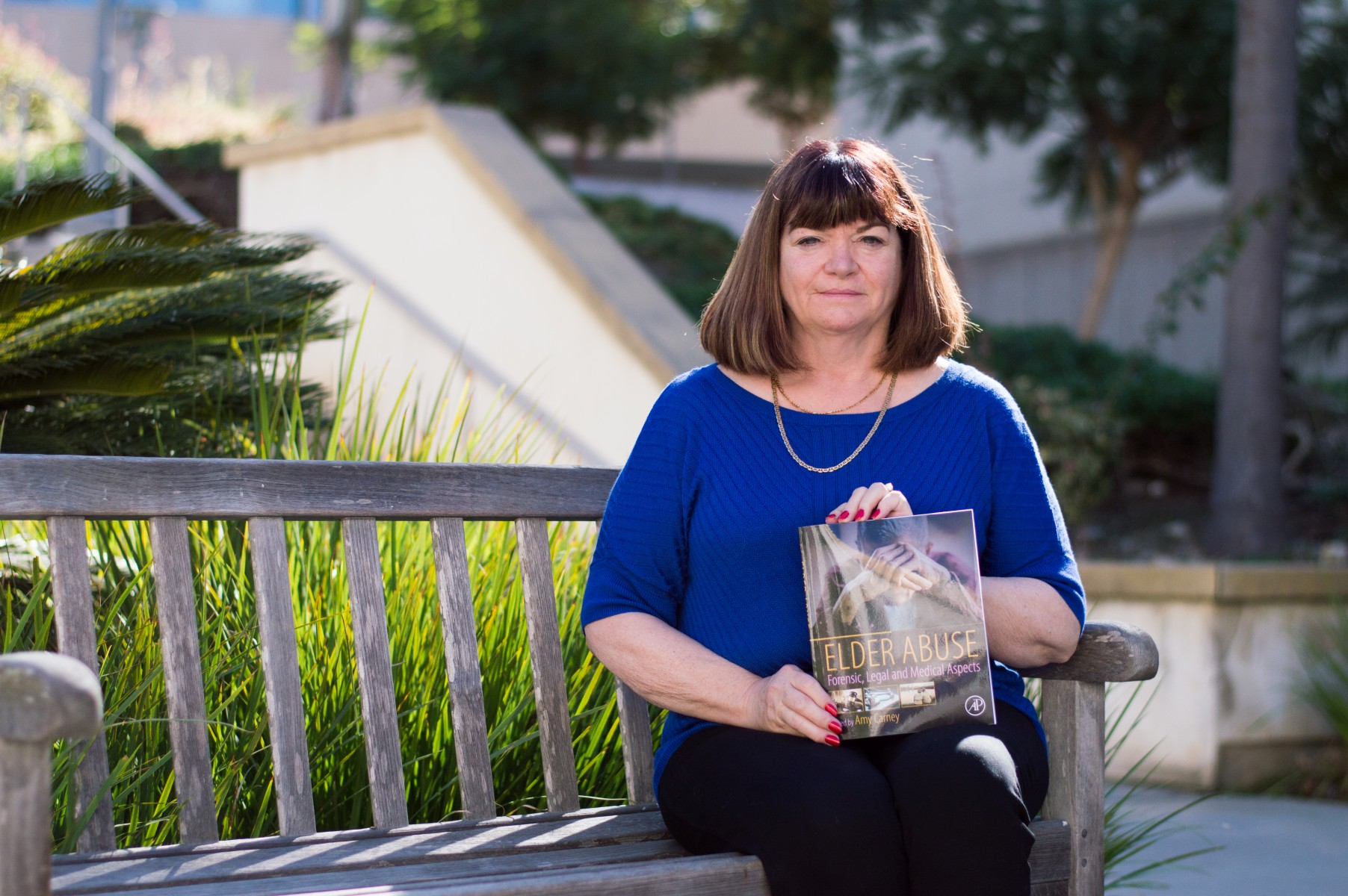 "Amy Carney, an associate professor in the School of Nursing, has co-written and edited, ""Elder Abuse: Forensic, Legal and Medical Aspects."" Photo by Angelica Pena"
