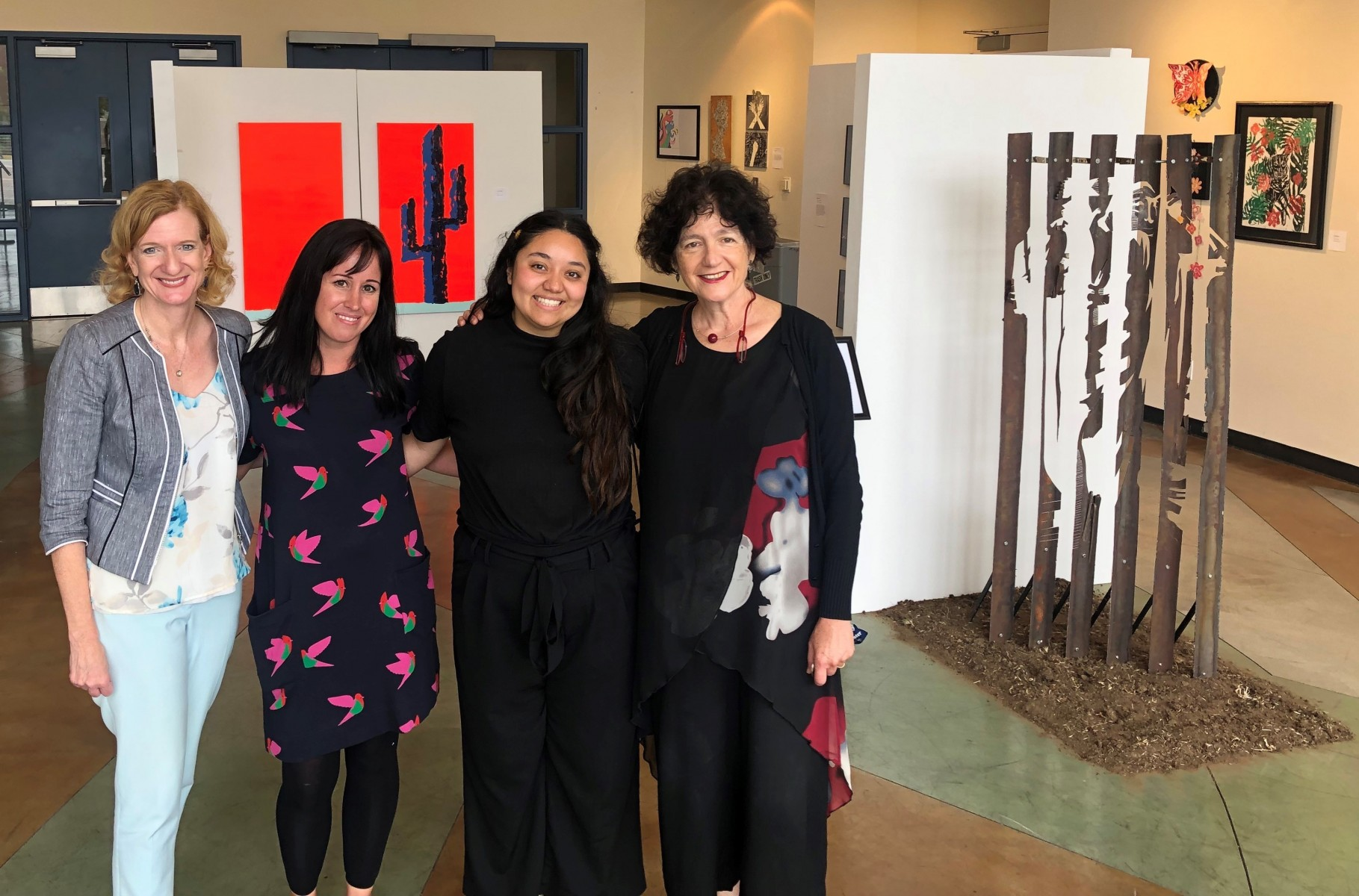 President Ellen Neufeldt (left) checked out the opening of the Juncture exhibit on Sept. 26. She's pictured with co-curators Sarah Bricke and Kimberly Lopez, and Judit Hersko (right), chair of the Art, Media and Design department.