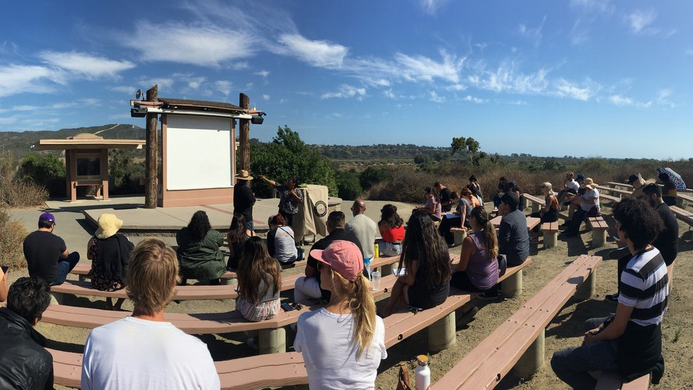 Students of American Indian studies lecturer Dina Gilio-Whitaker listen to a presentation on a Native American sacred site of the Acjachemen nation in San Clemente.