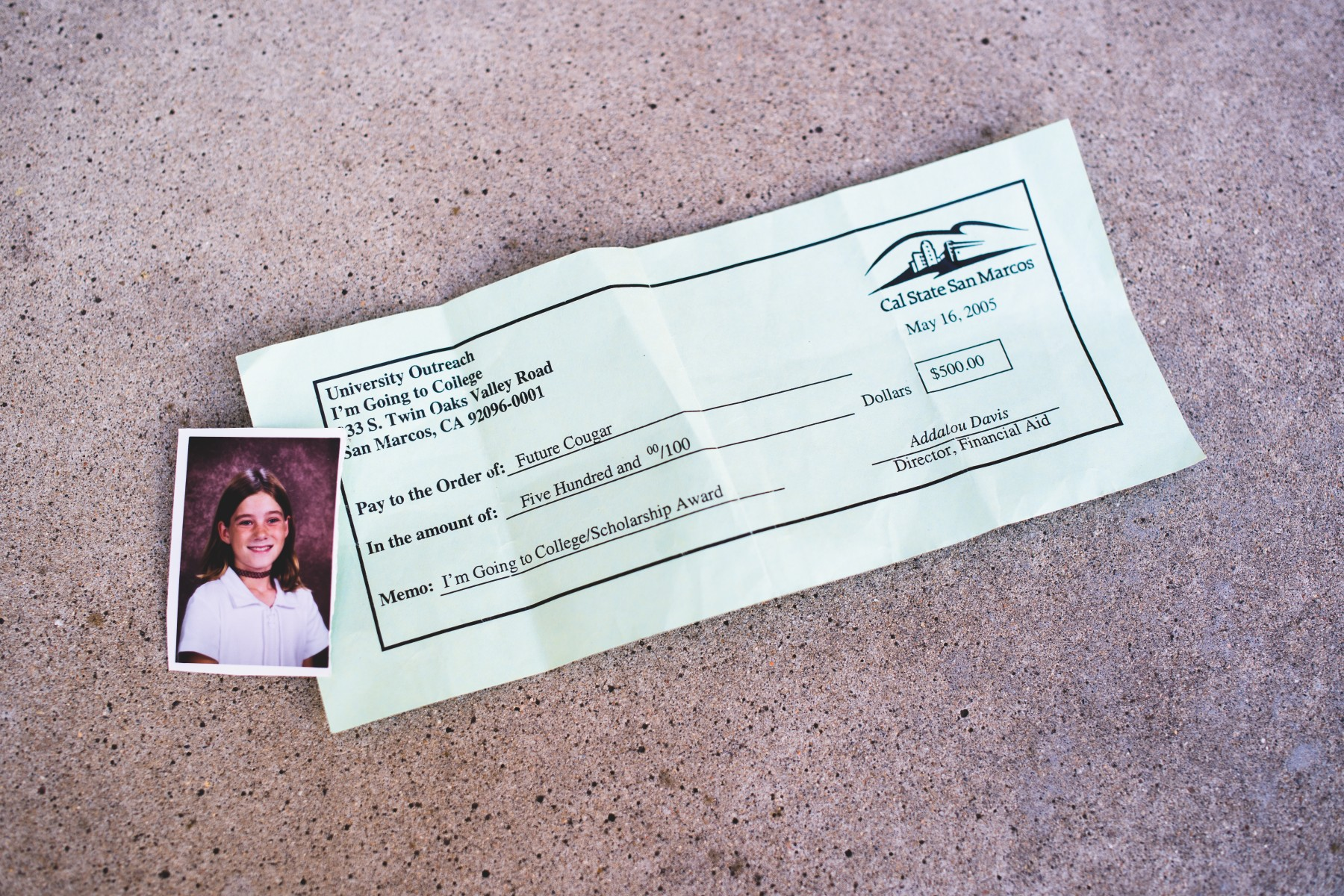 CSUSM student Chloe Hartman's mom kept this mock check that her daughter received on a field trip. More than a decade later, an anonymous donor honored it. Photo by Alan Brown