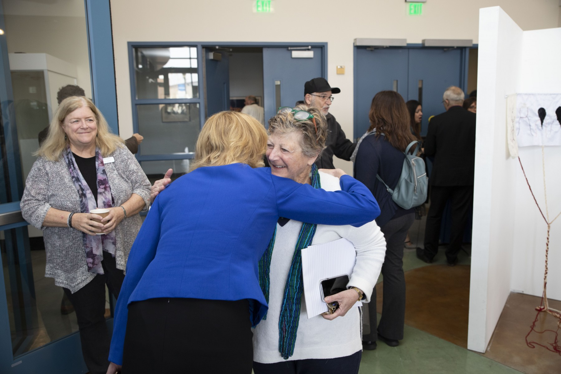 President Ellen Neufeldt greets professor Merryl Goldberg before the spring Academic Assembly to kick off the spring semester. Photo by Andrew Reed