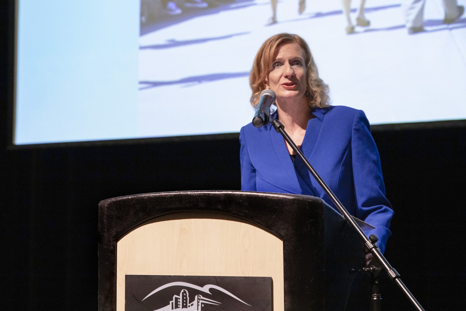 President Ellen Neufeldt, pictured speaking at the spring Academic Assembly, will deliver her first Report to the Community on Feb. 6. Photo by Andrew Reed