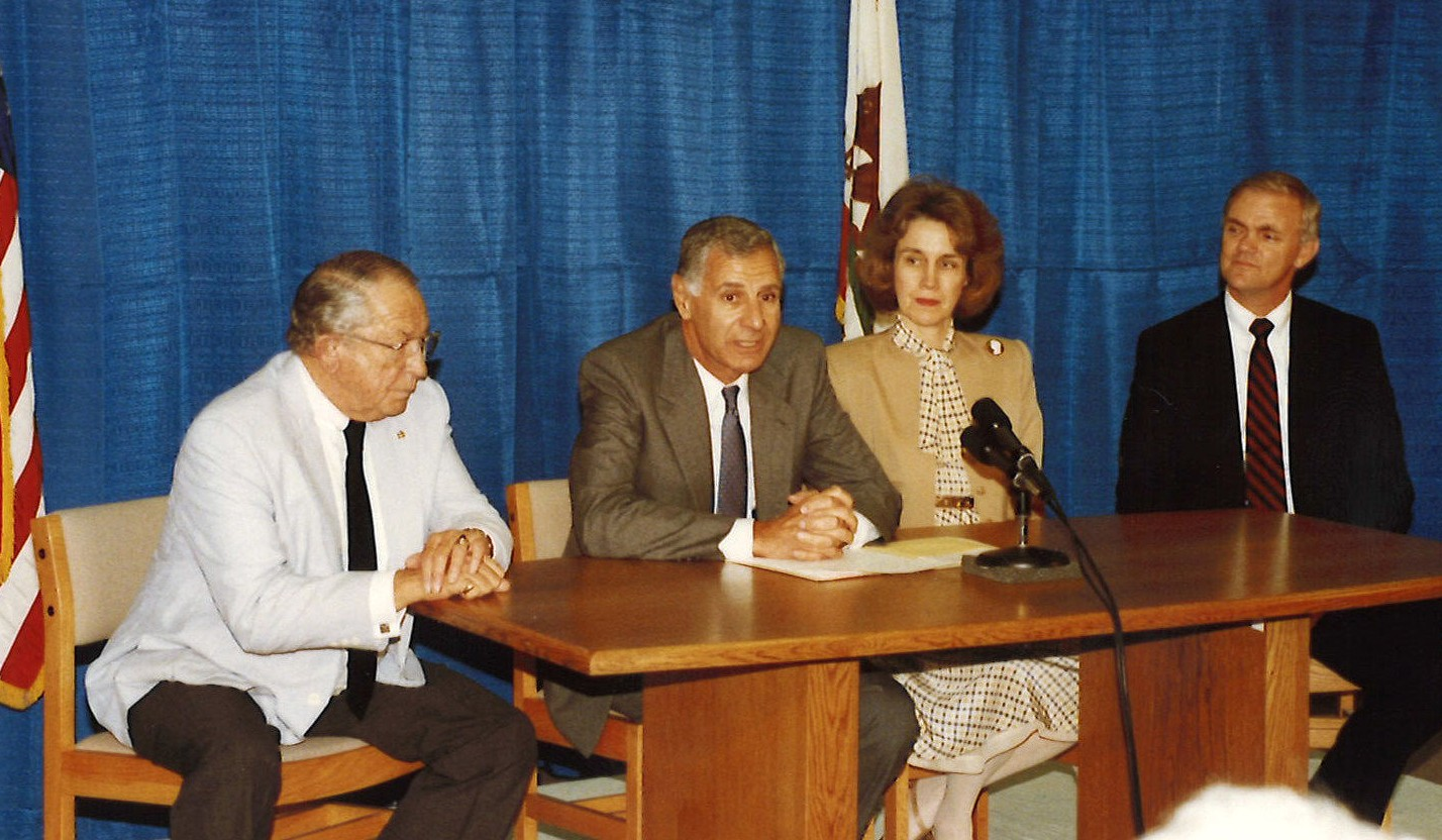 Senator Craven, Governor Deukmejian, Chancellor Reynolds and President Stacy at the signing of Senate Bill 365.