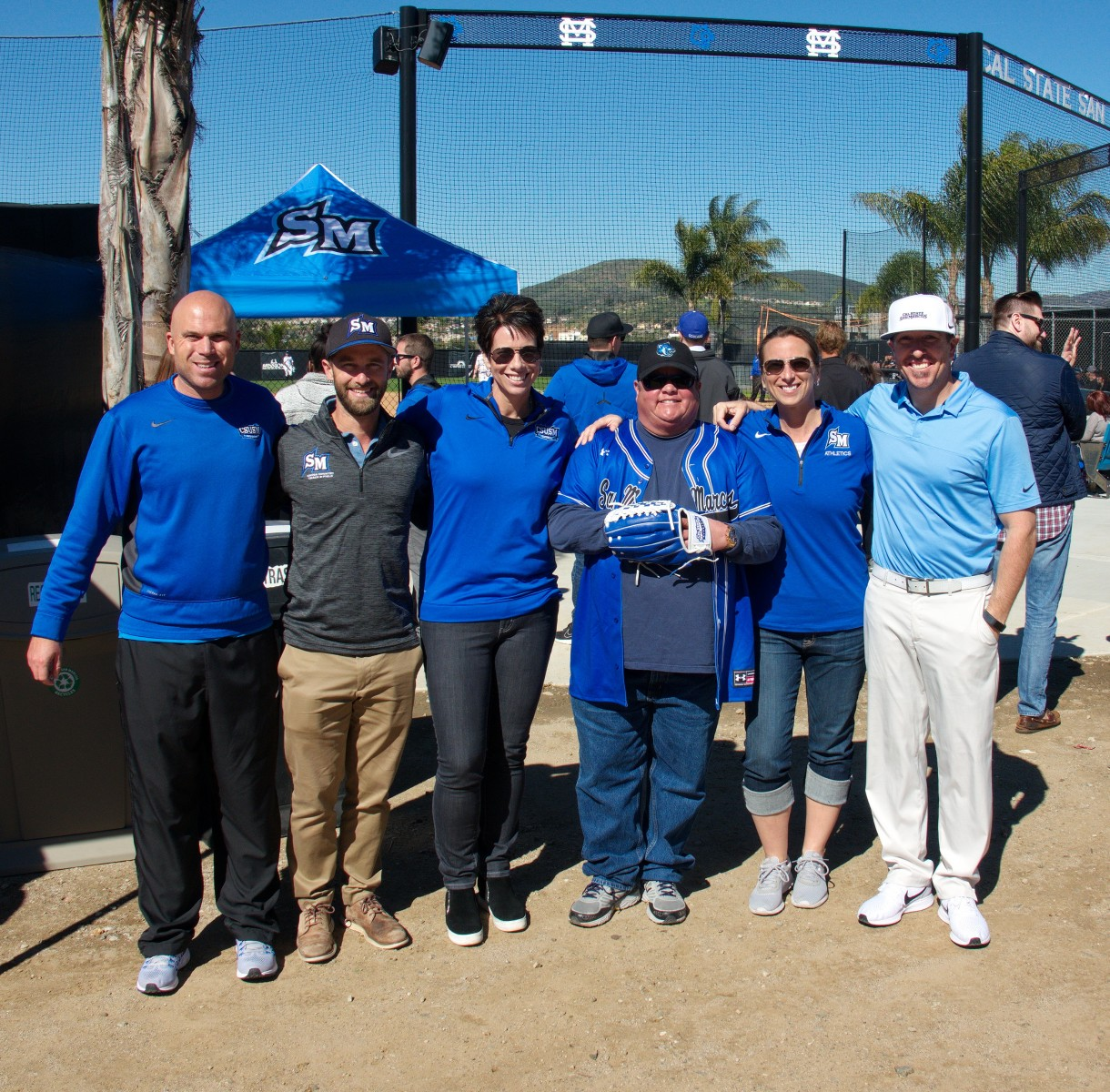 From left to right, Bobby Renneisen, Torrey Olson, Jennifer Milo, Fox Russell, Andrea Leonard and Greg Hutton before a softball game. Fox surprised the CSUSM athletic department with a $100,000 gift for CSUSM Giving Day last November.