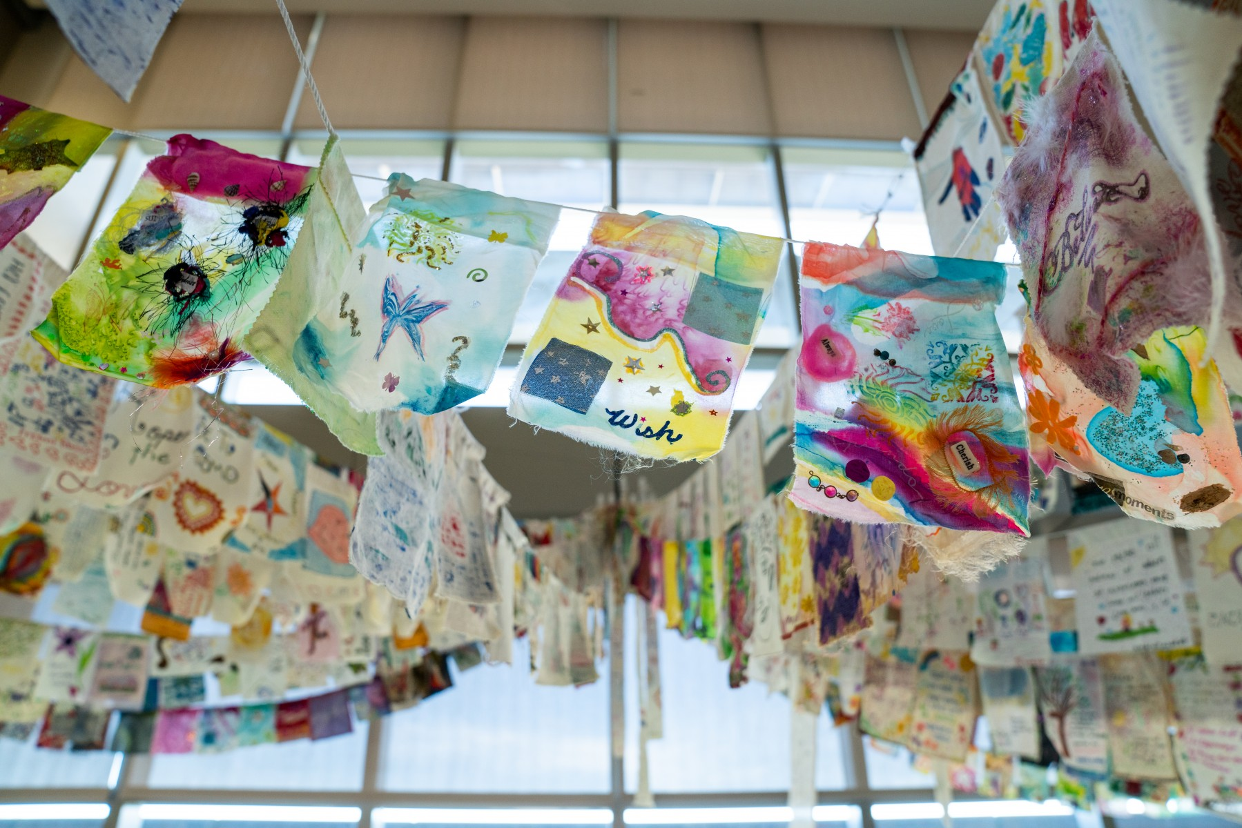 Hope Made Visible is a new art exhibit in the University Library consisting of close to 1,500 art flags made by cancer patients and their loved ones from around the world. Photo by Chandler Oriente