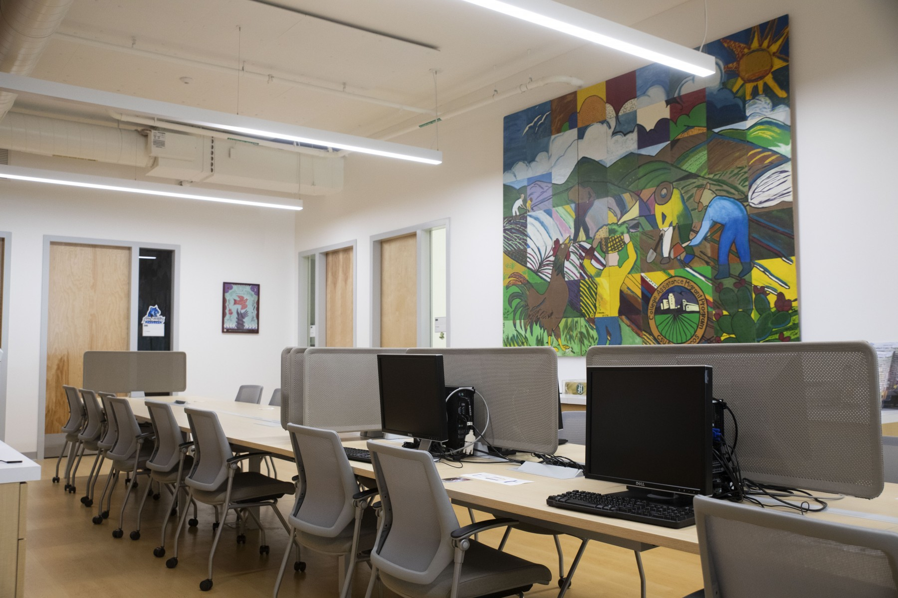 The CAMP office in the Extended Learning building is adorned with a colorful mural that pays tribute to farmworkers in California. Photo by Andrew Reed
