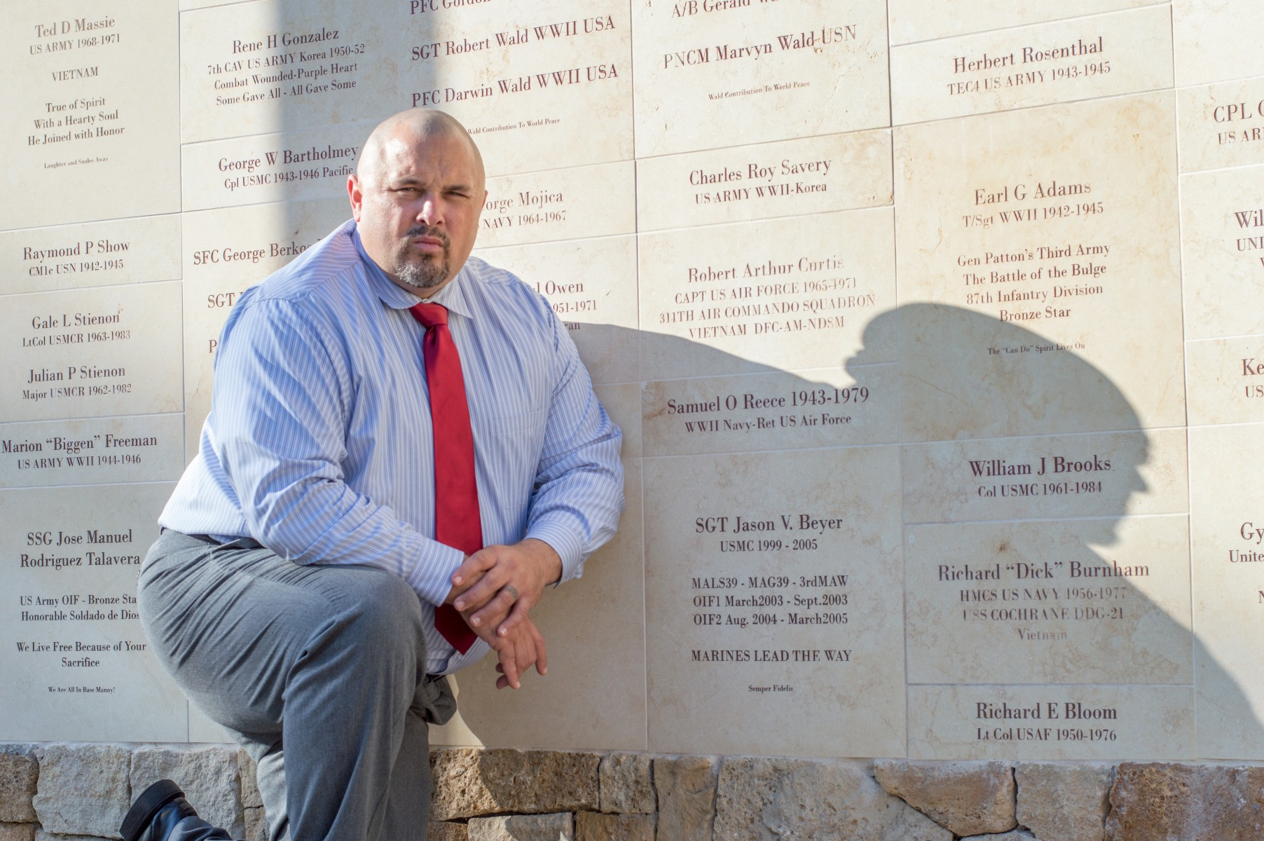 Jason Beyer is a CSUSM business student and Marine veteran who's leading an initiative to expand the memorial wall at Helen Bougher Memorial Park in San Marcos. Photo by Angelica Pena