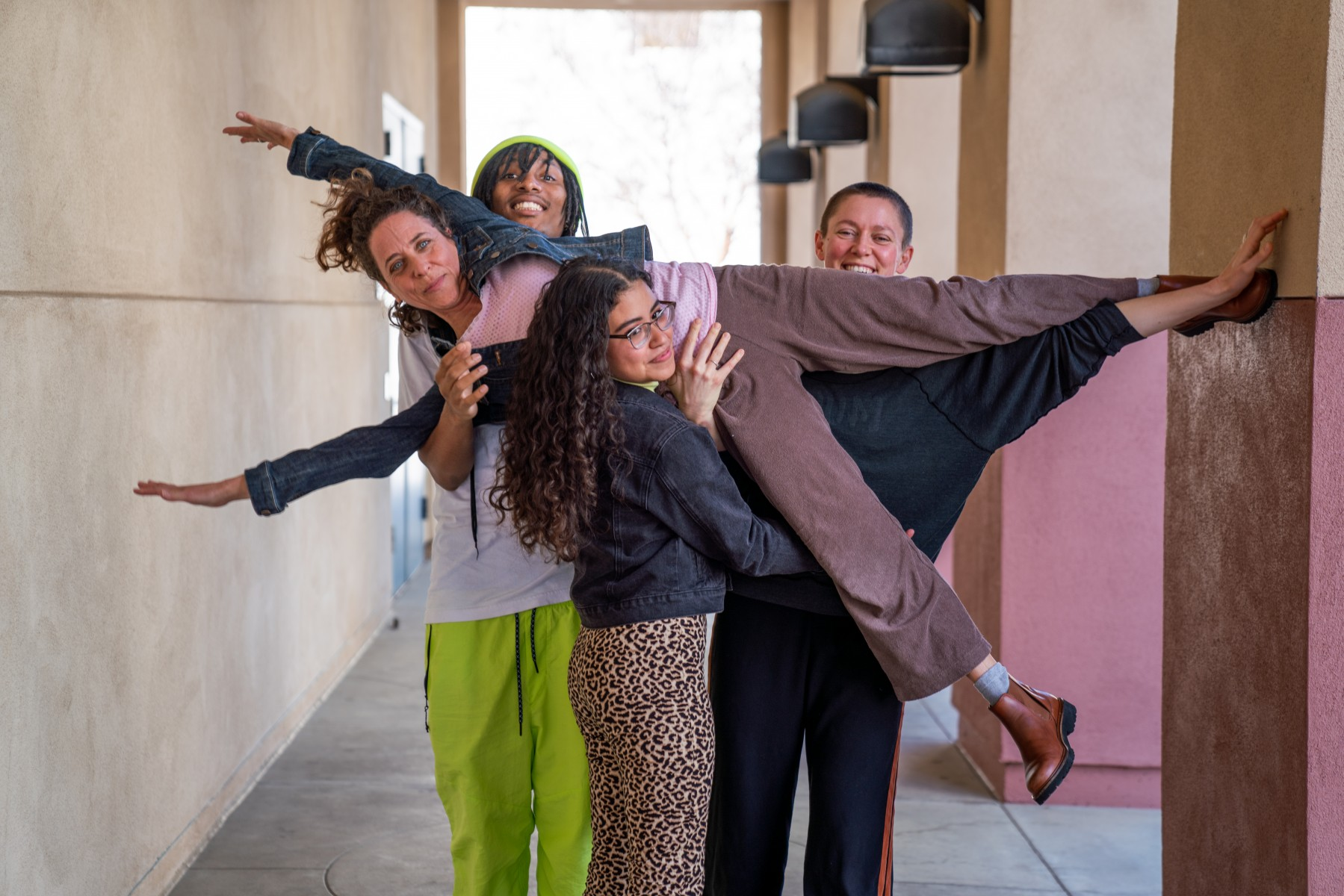 Karen Schaffman is lifted up by (from left to right) Caiser LeBoss Owens, Lesly Rodriguez and Anya Cloud. Photo by Chandler Oriente