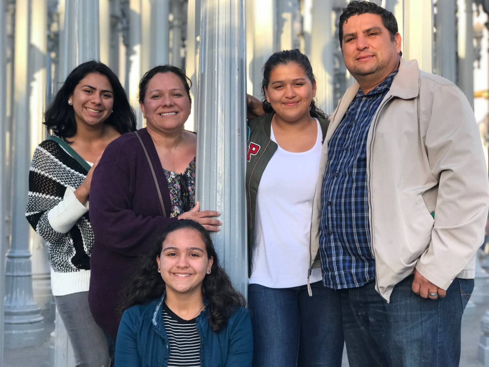 Kathleen Parra (far left) with family members (from left to right) Alicia, Evelyn, Angelina and Rigoberto. Kathleen will become the first in her family to graduate from college in spring 2021.