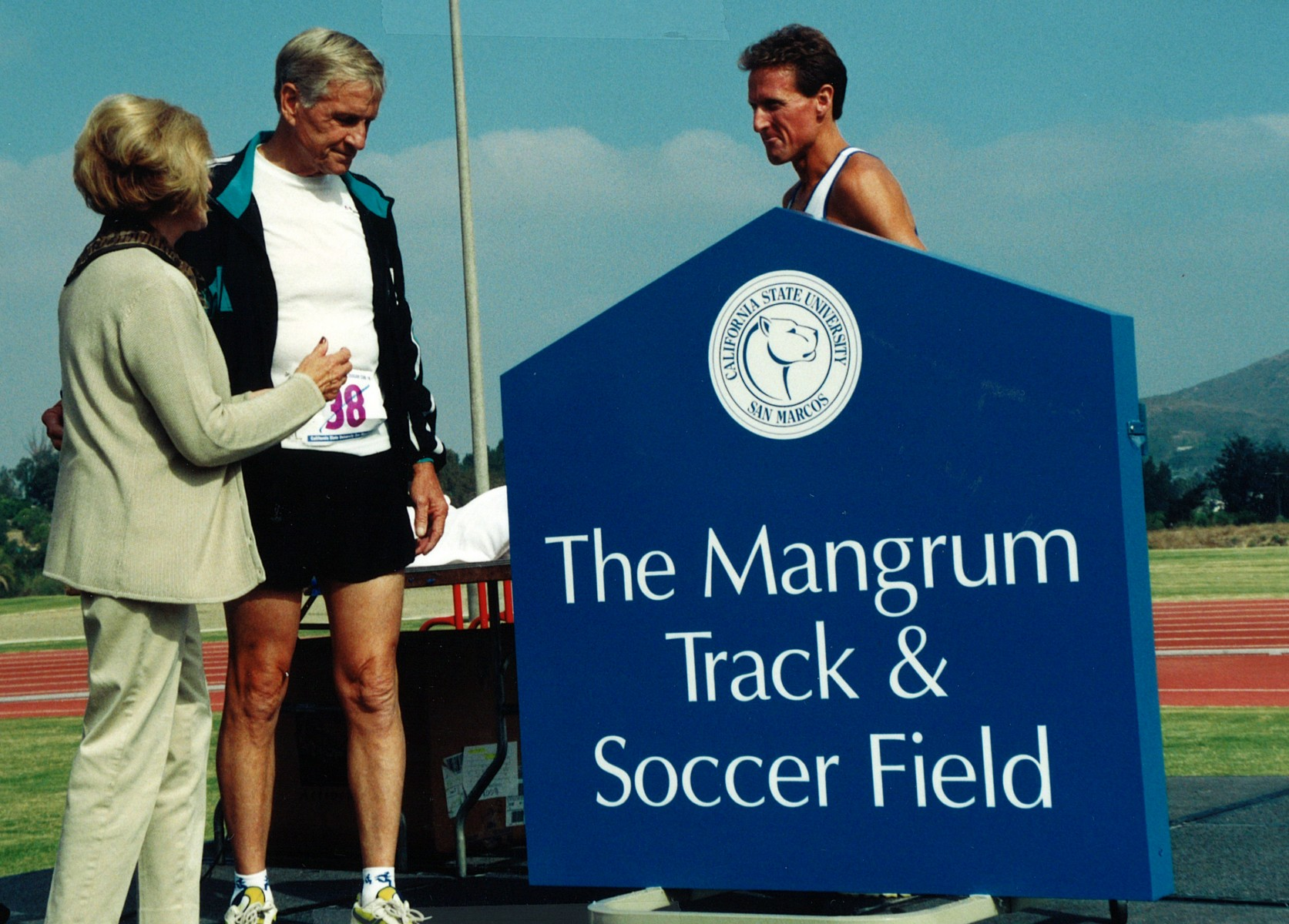 Bob and Ruth Mangrum join Steve Scott at the unveiling of the sign at The Mangrum Track & Soccer Field.