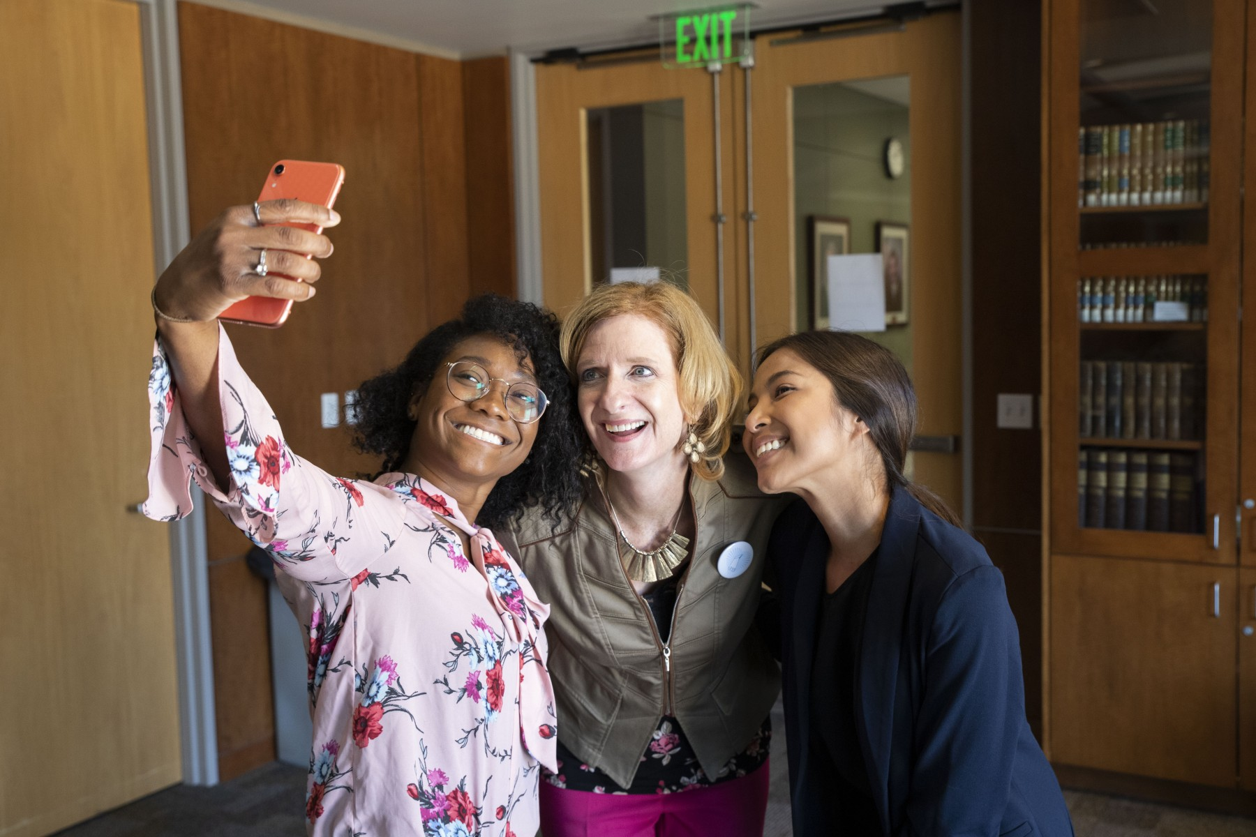 President Ellen Neufeldt takes time for a selfie with Holly Hampton (left), the library's head of user services, and Linly Sasinouan, administrative support coordinator for the library.