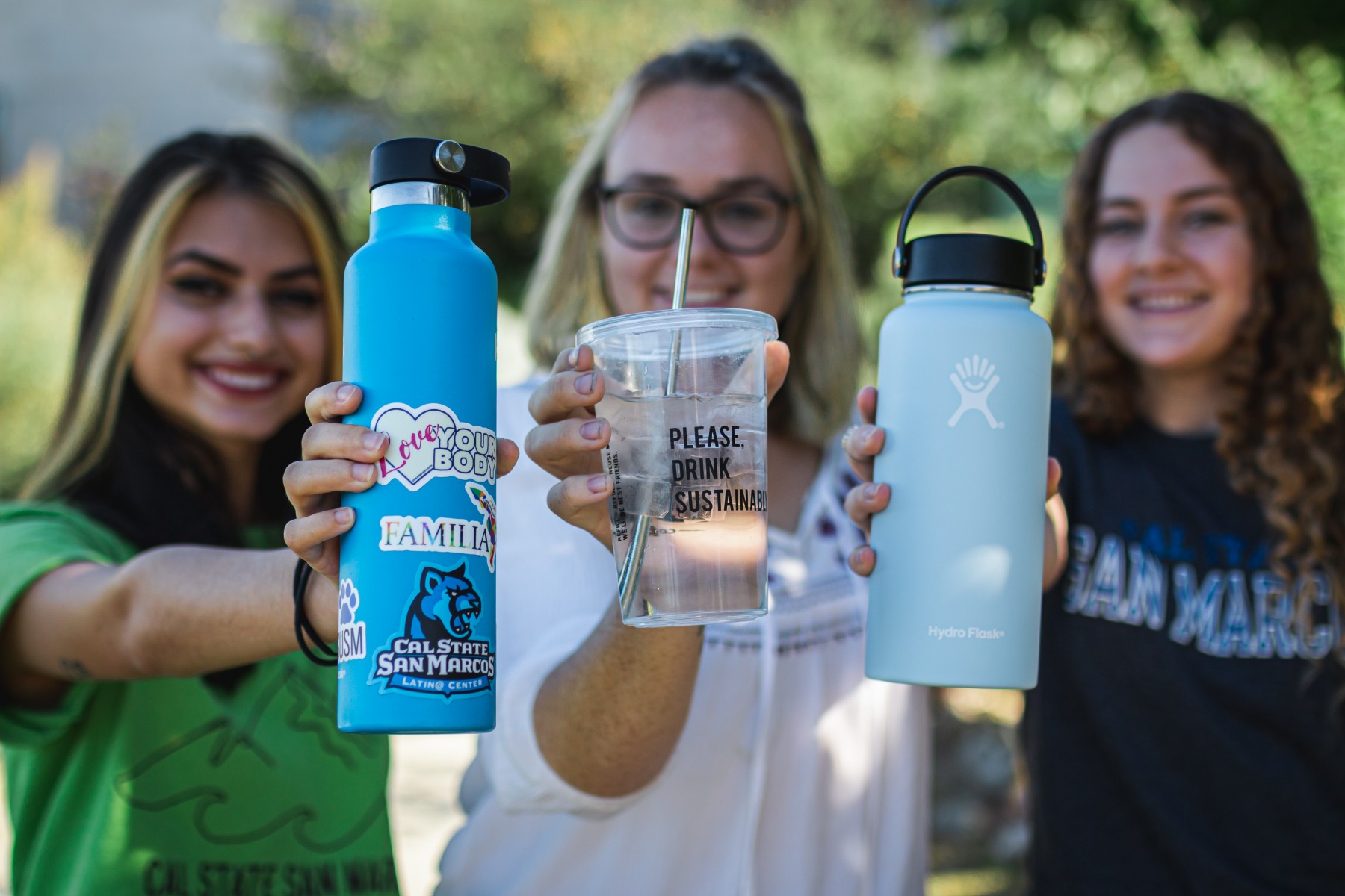 Students show off their sustainable drinking containers before the pandemic. The university recently earned a STARS Gold Rating in recognition of its sustainability achievements.