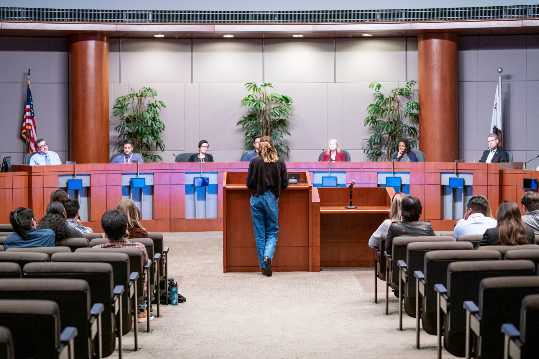 """It was a great opportunity to start the conversation of how we can enhance the city,"" said Addalee Lyon, a CSUSM Art, Media and Design student pictured giving a presentation to San Marcos city officials last month. Photo by Chandler Oriente"