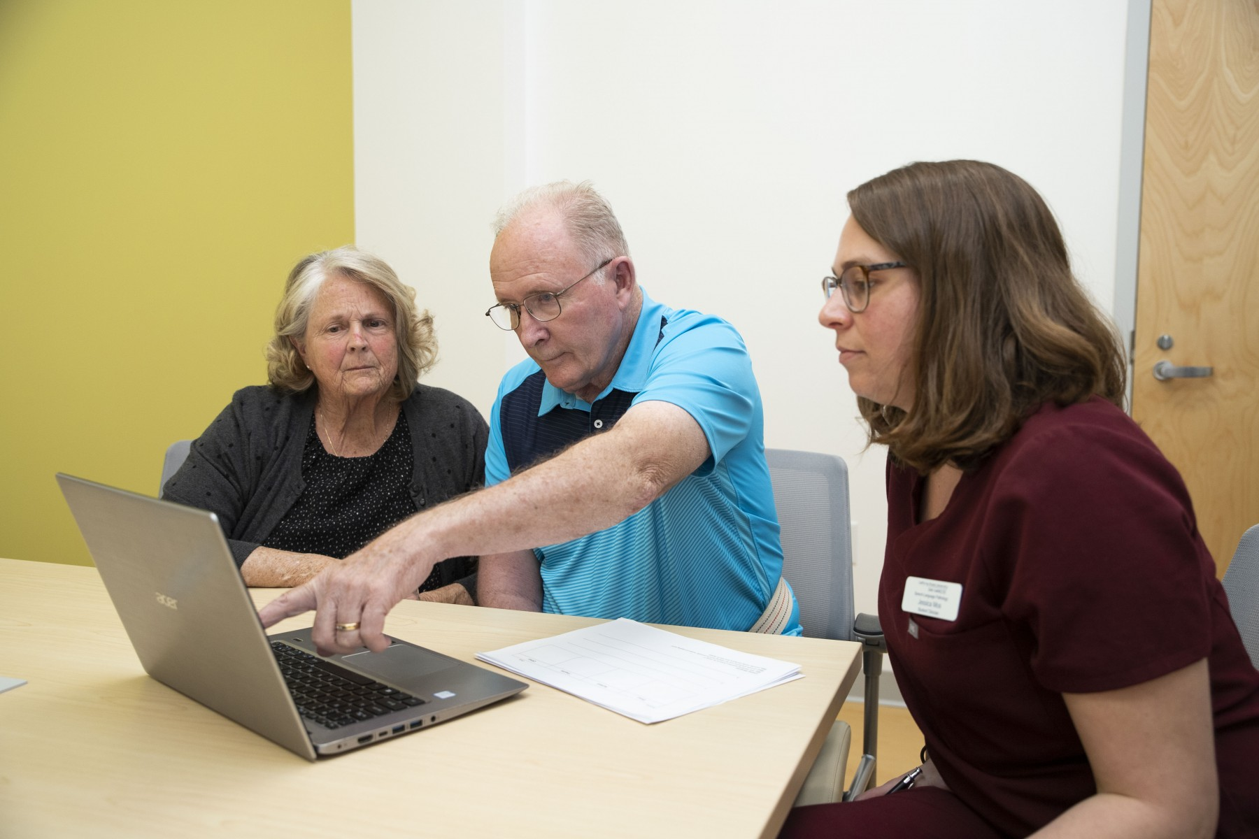 Norm Bishop (center) and his wife, Alice, work with CSUSM student Jessica Mos at the Speech-Language Clinic  in the Extended Learning building in February. The clinic soon shut down because of the coronavirus and is now offering telehealth services. Photo by Andrew Reed
