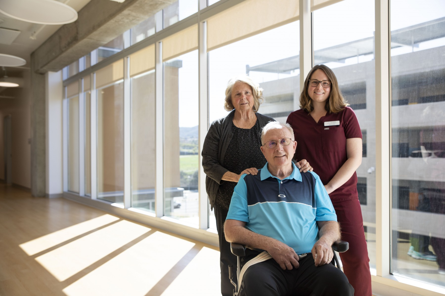 """We're in it for the long run,"" Alice Bishop (left) said of the services offered by the Speech-Language Clinic. She's pictured at the clinic in February with her husband, Norm, and Jessica Mos, a master's student in speech-language pathology. Photo by Andrew Reed"
