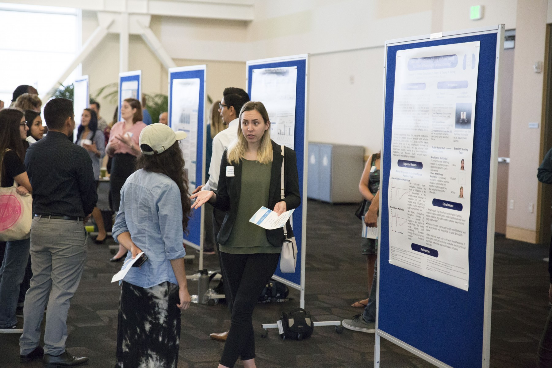 CSUSM students participate in the 2018 Summer Scholars Poster Showcase.