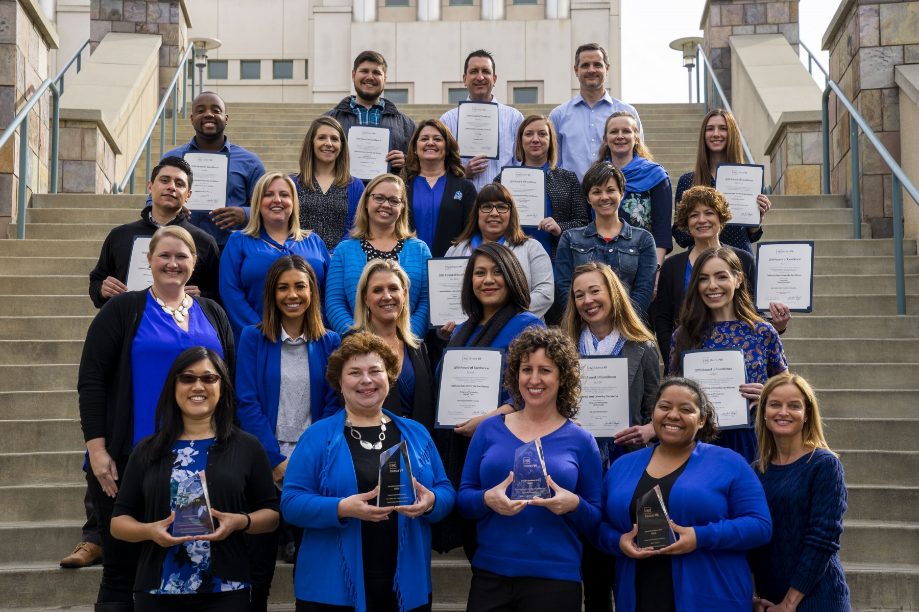 Vice President Cathy Baur joins members of her University Advancement team in February 2019 to celebrate the department receiving 11 awards at a regional conference for the Council for Advancement and Support of Education (CASE), a membership association serving educational institutions and the advancement professionals who work on their behalf in alumni relations, communications, development, marketing and allied areas.