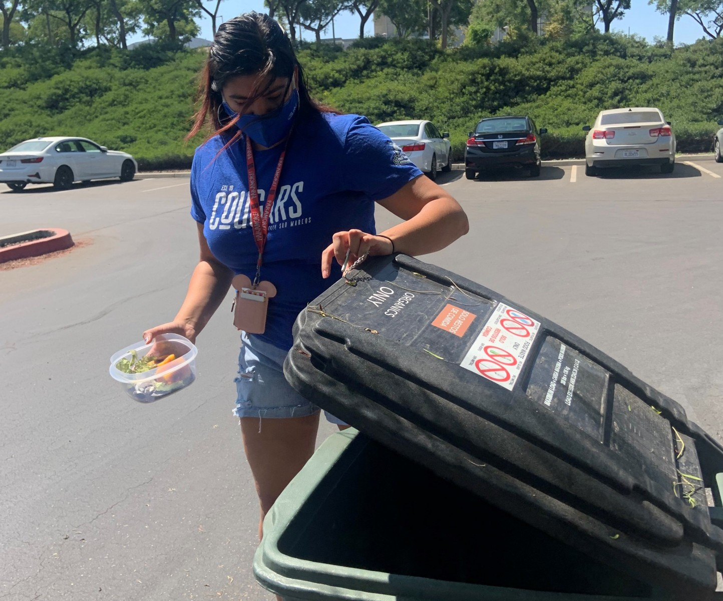 Student Miranda Arias uses the composting bin outside of the UVA.
