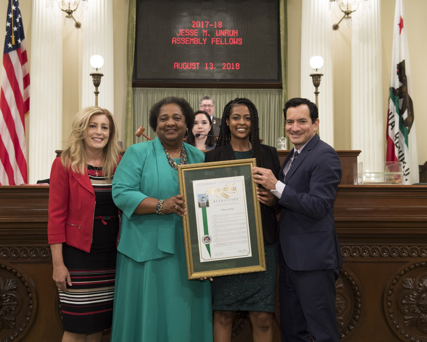 Cal State San Marcos alumna Tiffaney Boyd (second from right) is a legislative aide to California State Assemblymember Shirley Weber of San Diego (second from left). Here she's pictured in the state capitol building after completing the Capital Fellows program in 2018.