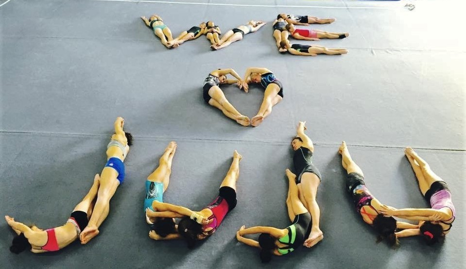 "After her brain tumor diagnosis in 2015, Juliana Abraham's gymnastics teammates show their support by forming a ""We Love Juju"" message, a nod to Abraham's nickname. Her teammates shared the picture on social media with the hashtag #joinforjuju."