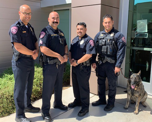 Interim Police Chief Lamine Secka (left to right), Sgt. Herman Hernandez, Lt. Jesse Flores and K-9 Officer David Angulo (with his partner, Armor) are among the officers who are wearing pink patches this month.  Photo by Kristin Erickson