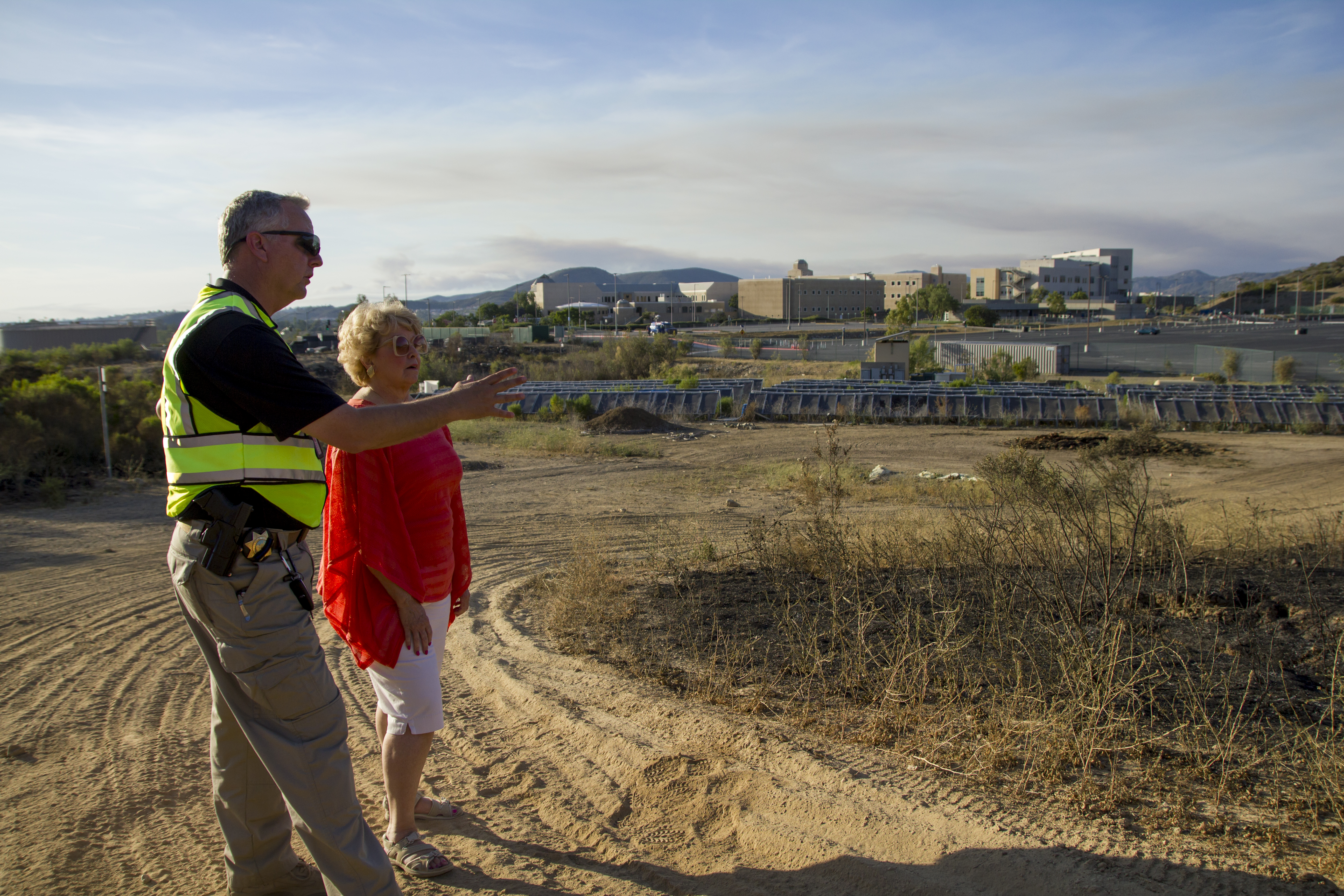 Chief McManus and President Haynes assess the hillside burned by the Cocos Fire