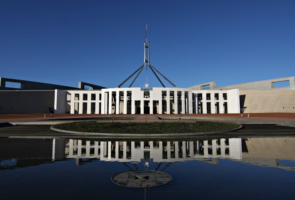 stock-photo-australia-s-parliament-house-and-reflection-canberra-18513916.jpg