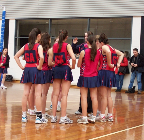 female netballers in a huddle