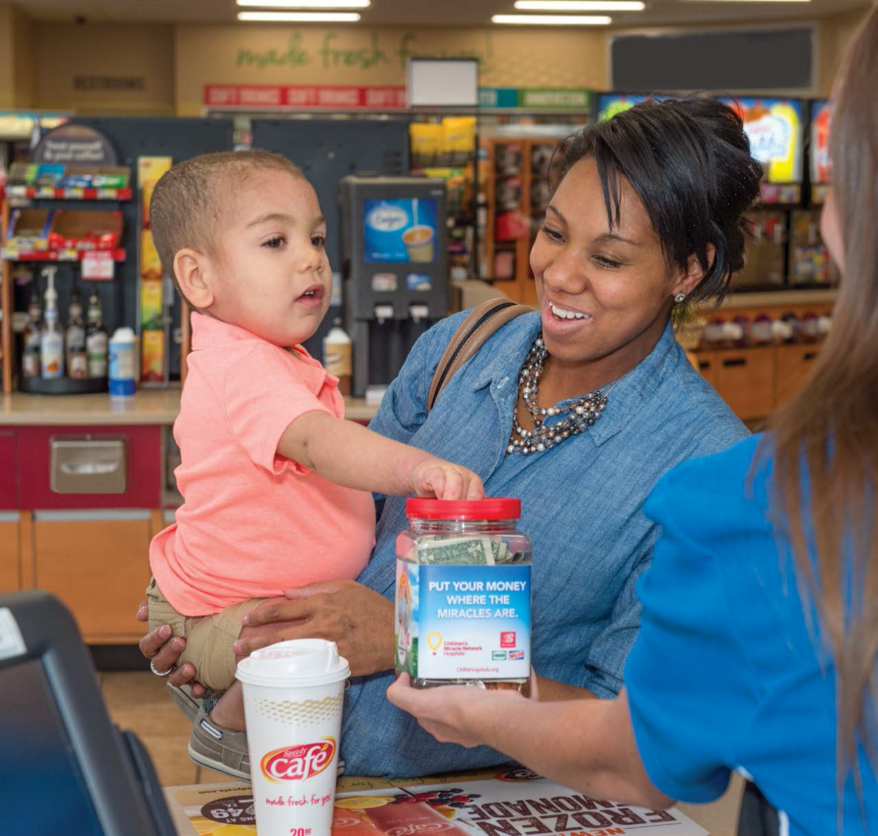 Two-year-old Dominic Corson puts his money where the miracles are by donating to Children's Miracle Network Hospitals at Speedway.