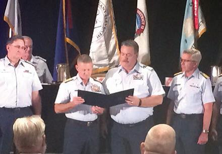 John Ellis (third from left) was honored with the Coast Guard Auxiliary Meritorious Service Medal for serving more than 23 years in the United States Coast Guard