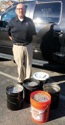 Bob Jarabeck inspired his fellow employees to collect several buckets of tabs to benefit Ronald McDonald House.
