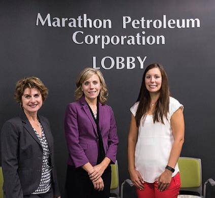 Gretchen Plewak, Canton refinery Human Resources manager (left) and Macy St. Clair, TT&R Human Resources consultant (right), join Marisa Rohn, Stark State College, in the lobby named for MPC at the Canton satellite campus of Stark State College.