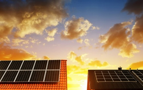 stock-photo-solar-energy-panel-on-the-roof-of-the-house-in-the-background-sunset-sky-the-concept-of-ecological-1051772642.jpg