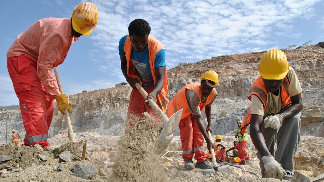 Men at work on the Grand Ethiopian Renaissance Dam project. (Jacey Fortin)