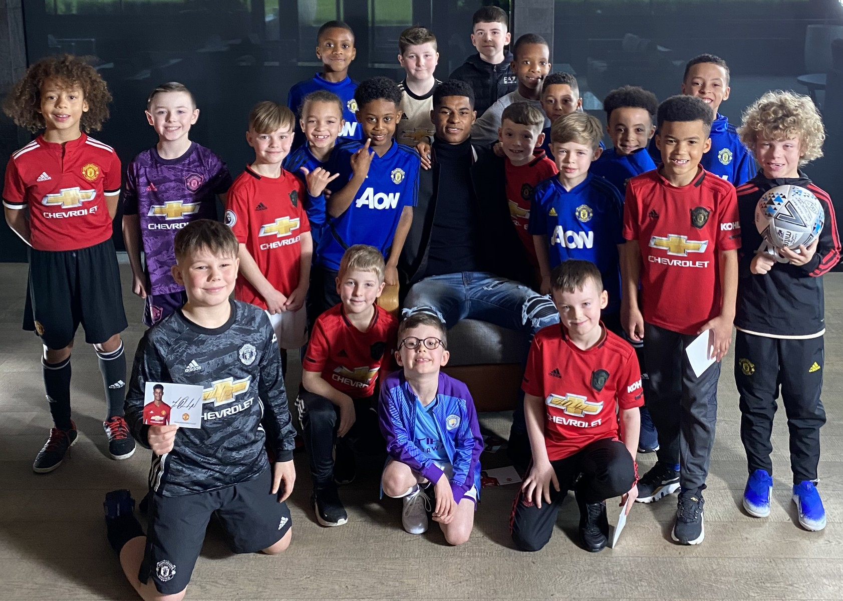 Marcus Rashford with group of fans
