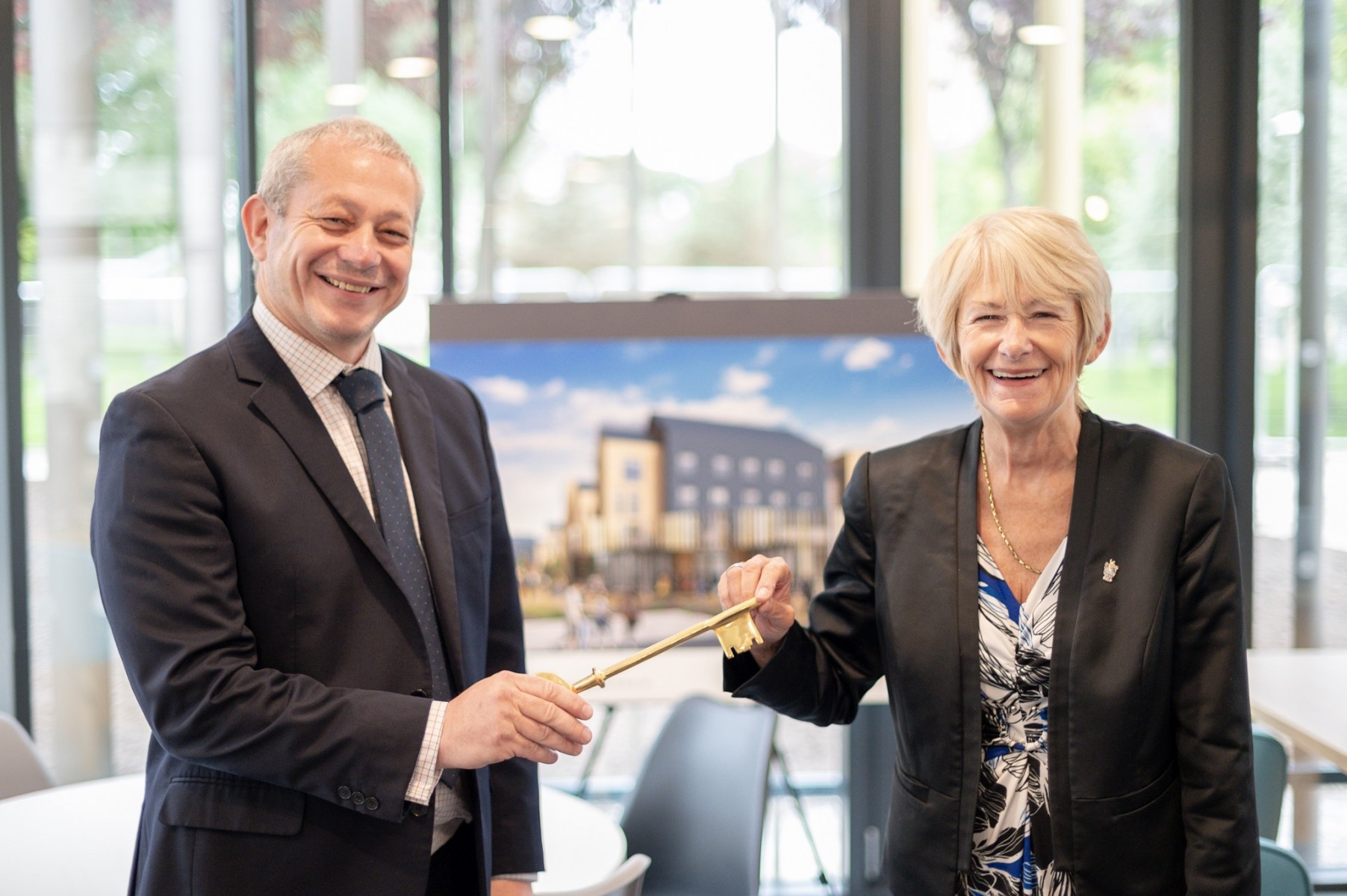 President and VC, Prof Dame Nancy Rothwell  with John Roberts, regional director of VINCI Construction UK Limited