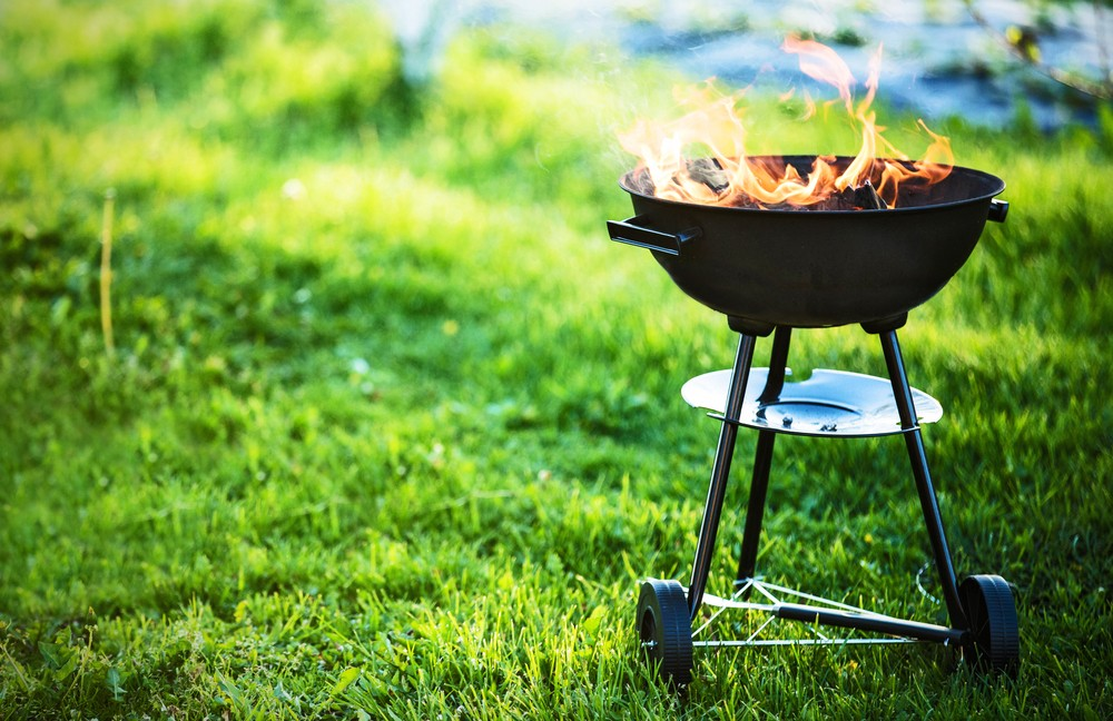 stock-photo-barbecue-grill-with-fire-on-nature-outdoor-close-up-645672055.jpg